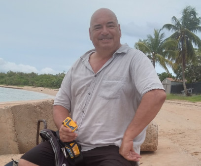 Solo yachtsman Nigel Fox with the Ocean Signal rescueME PLB1 that saved his life