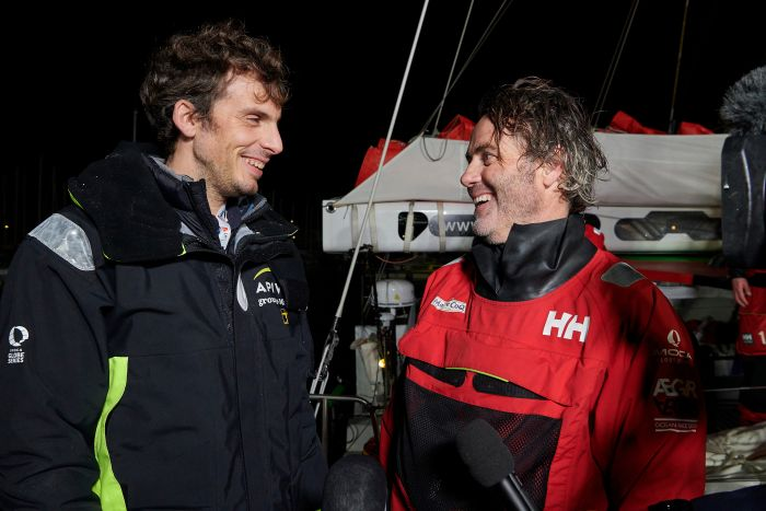 Charlie Dalin (Apivia) and Yannick Bestaven (Maitre Coq) talking on the dock.