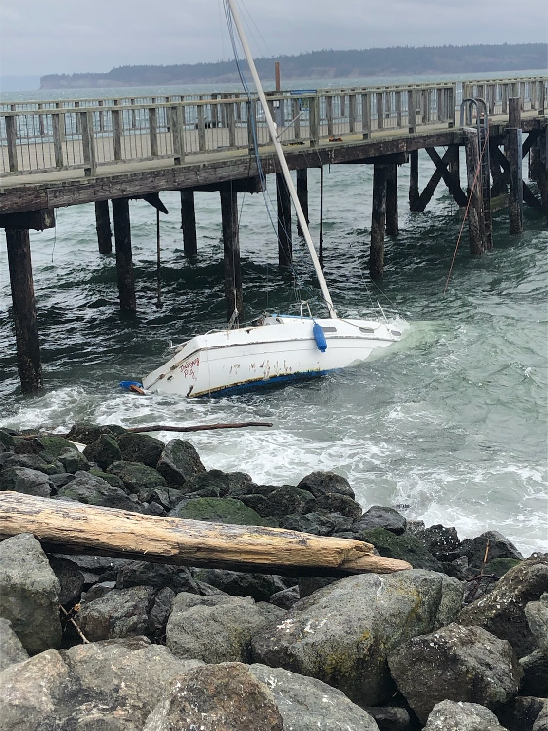 """A sailboat bearing the name """"Flying Pig"""" met an unfavorable fate Sunday near the city dock. PHOTO COURTESY PORT OF PORT TOWNSEND."""