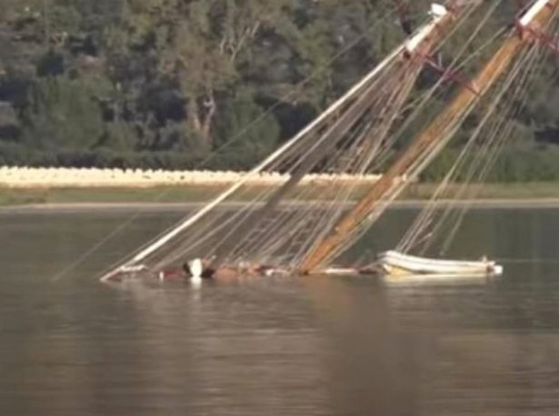 Strange story of man tied to mast on sunken yacht