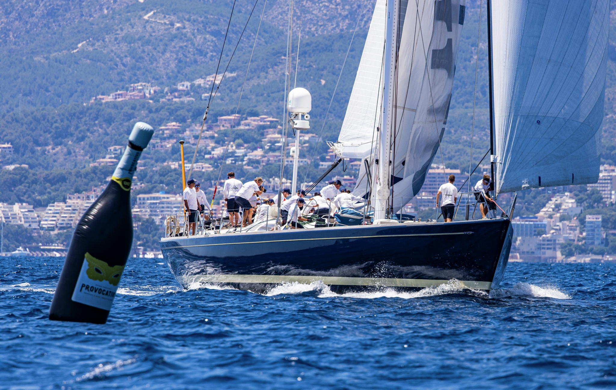 Superyacht Cup Palma 2021, a yacht nears the champagne designed rounding marker