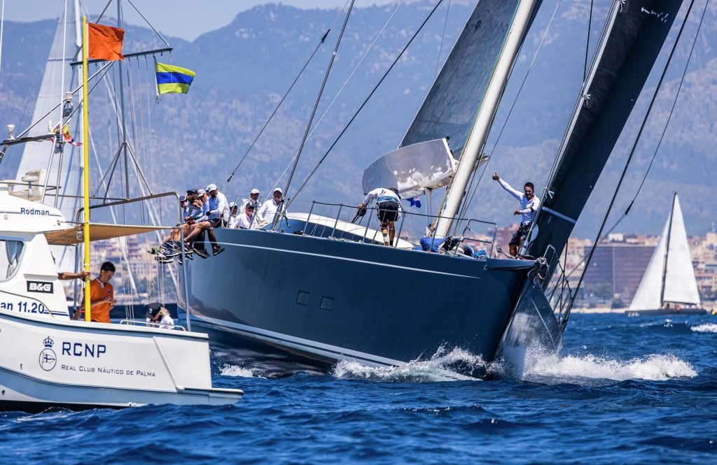 Superyacht Cup Palma 2021, a yacht approaches the start line.