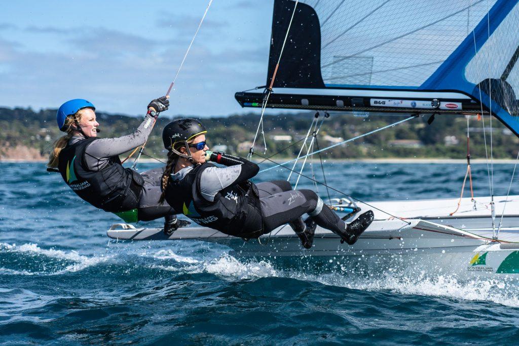 49erFX sailors Tess Lloyd and Jaime Ryan looking fast in Zhik gear.