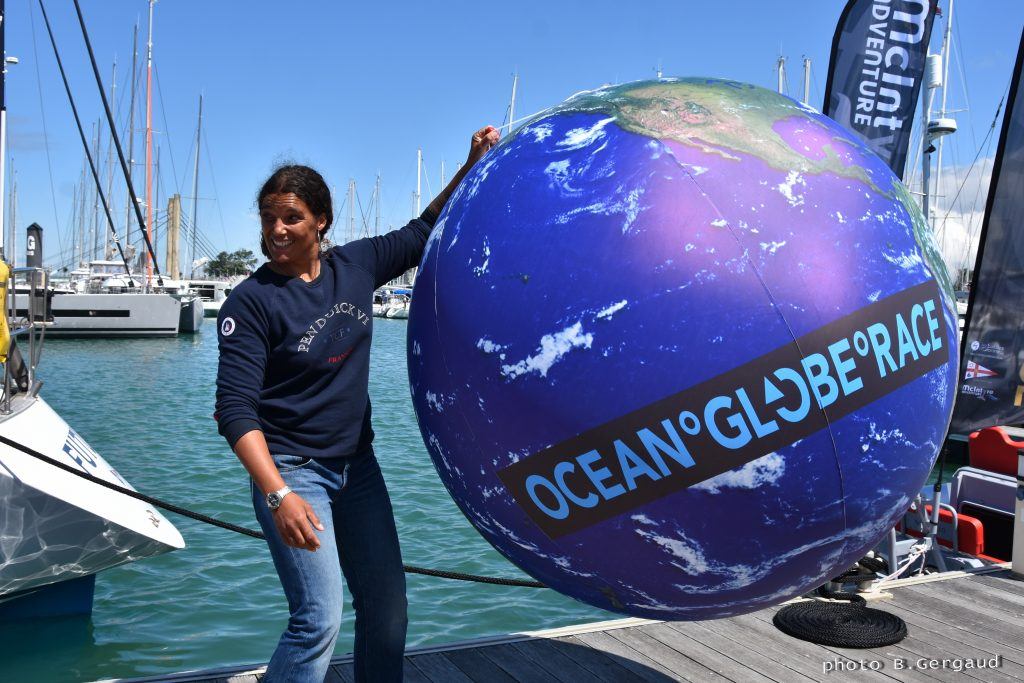 Marie Tabarly holding the  earth in ball form