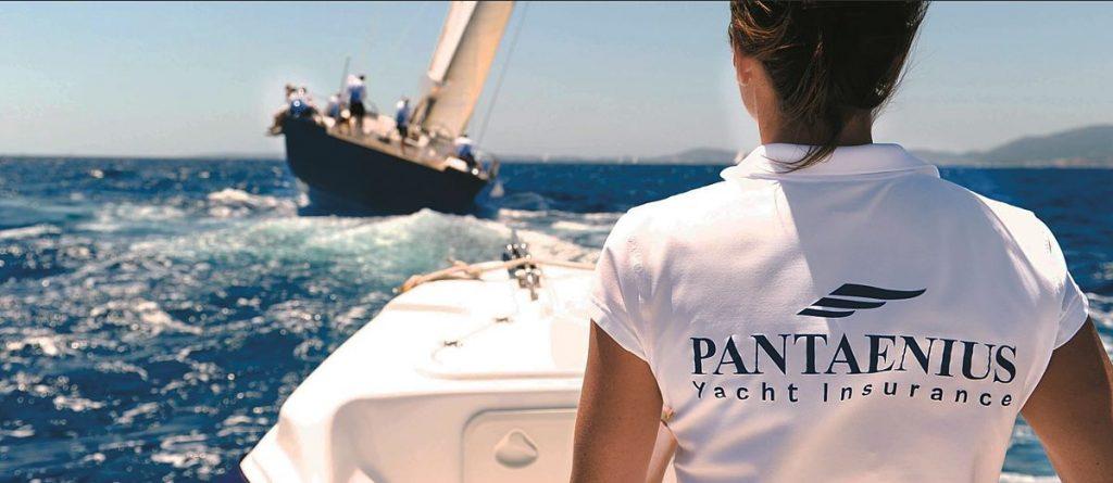 Person with Pantaenius shirt following a sailing yacht