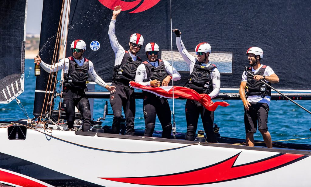 Alinghi celebrate their overall win with champagne