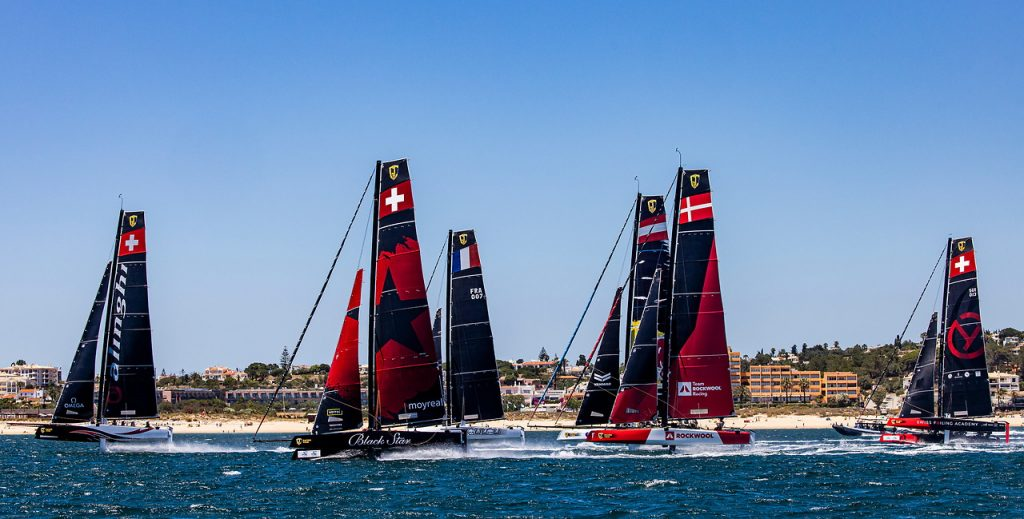 Team Alinghi lead the fleet upwind