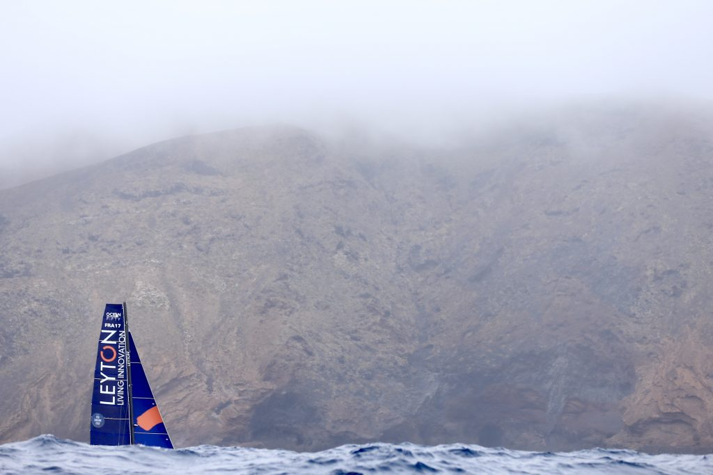 Leyton sails through fog, mountain backdrop