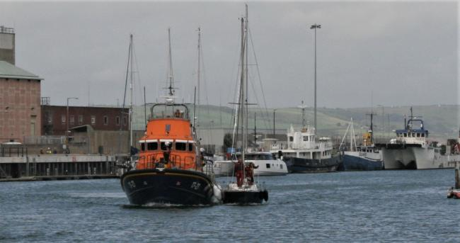 Weymouth Lifeboat tows in the yacht.