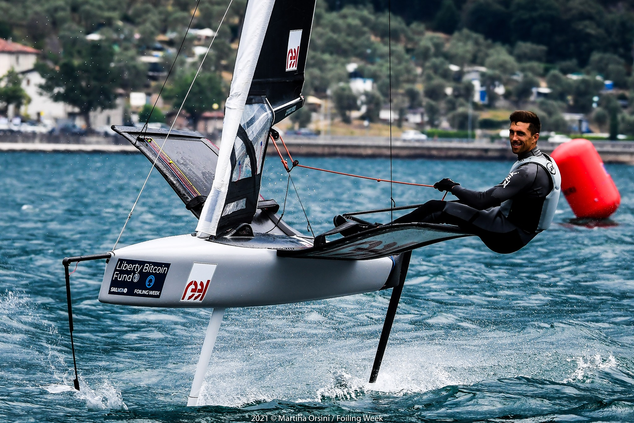 Smiling at the camera while foiling