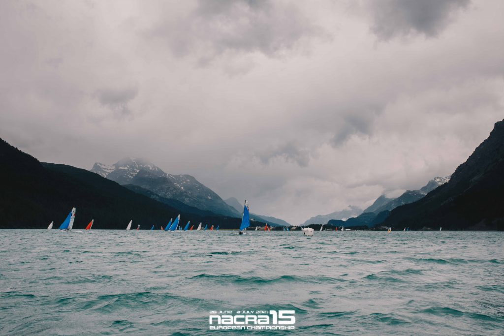 Boats scattered with beautiful backdrop of mountains