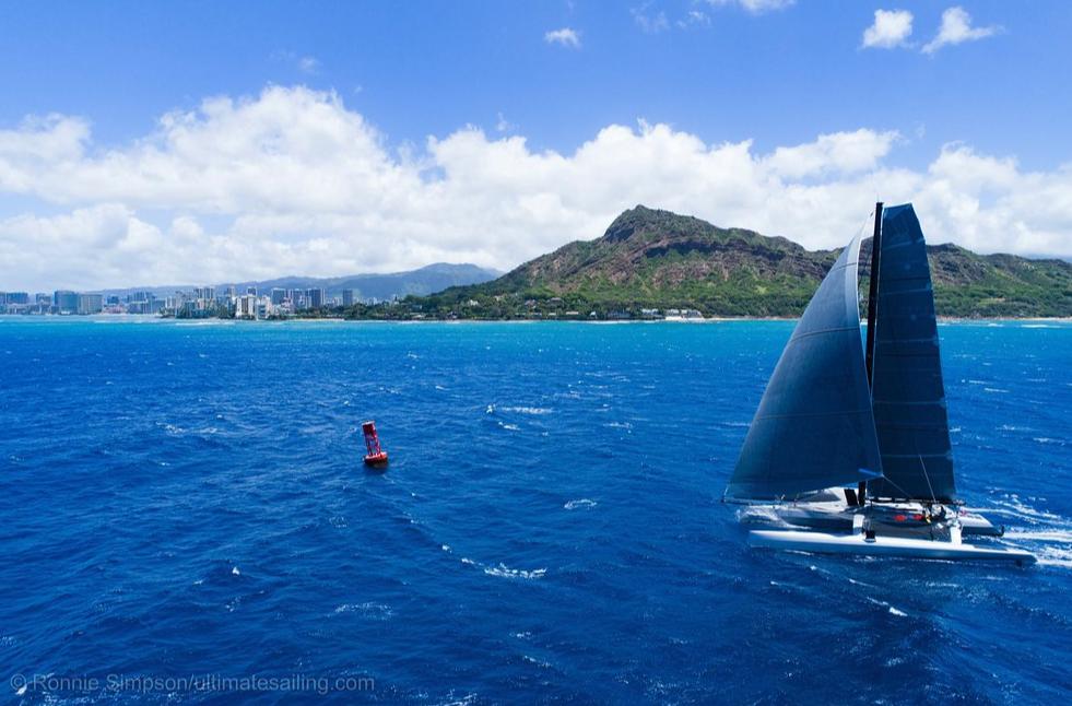 Catamaran sailing in beautiful blue water