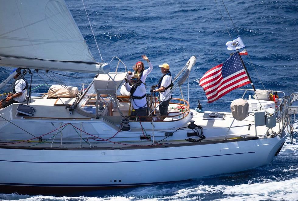 Sailors waving to camera