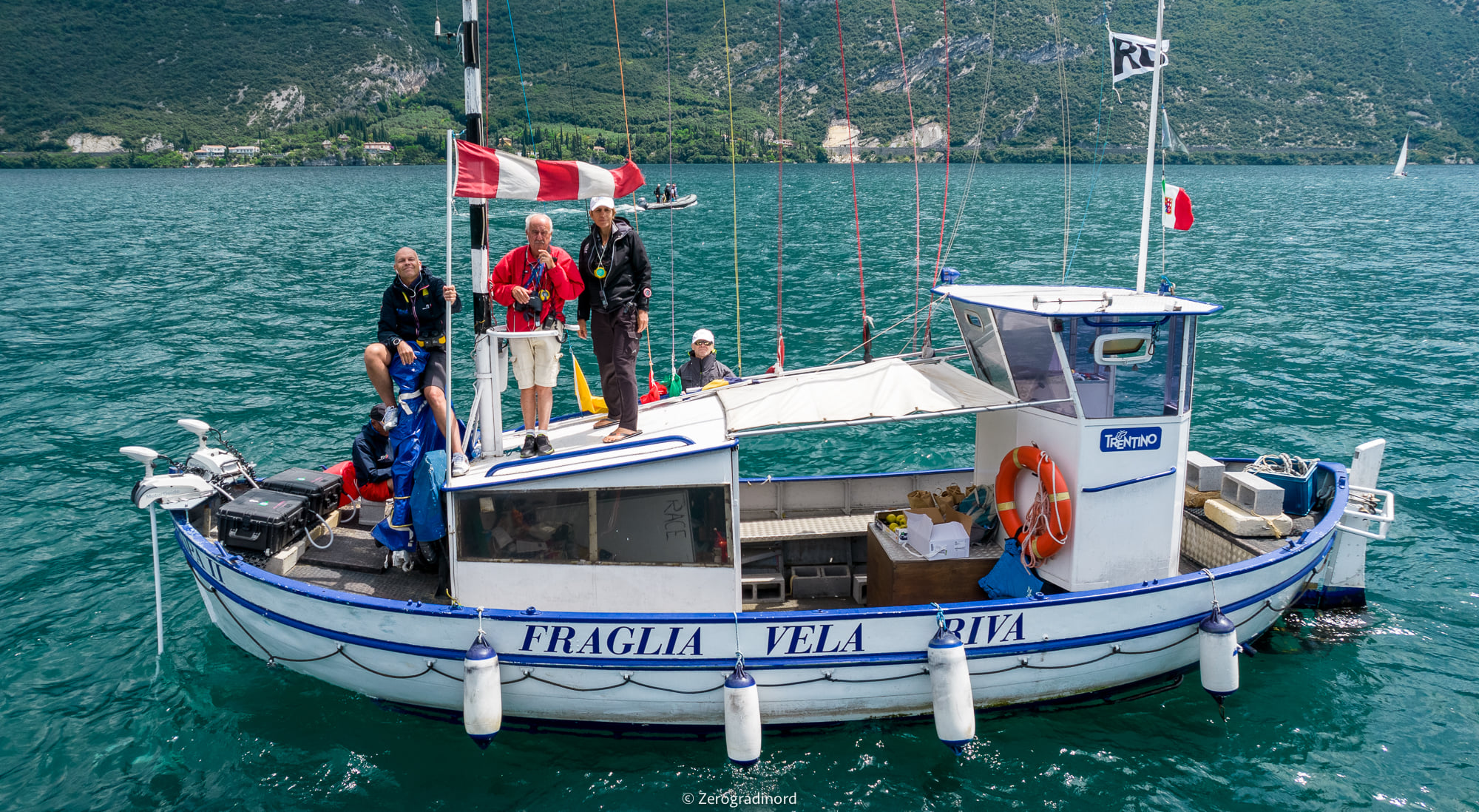 Race committee on the small boat