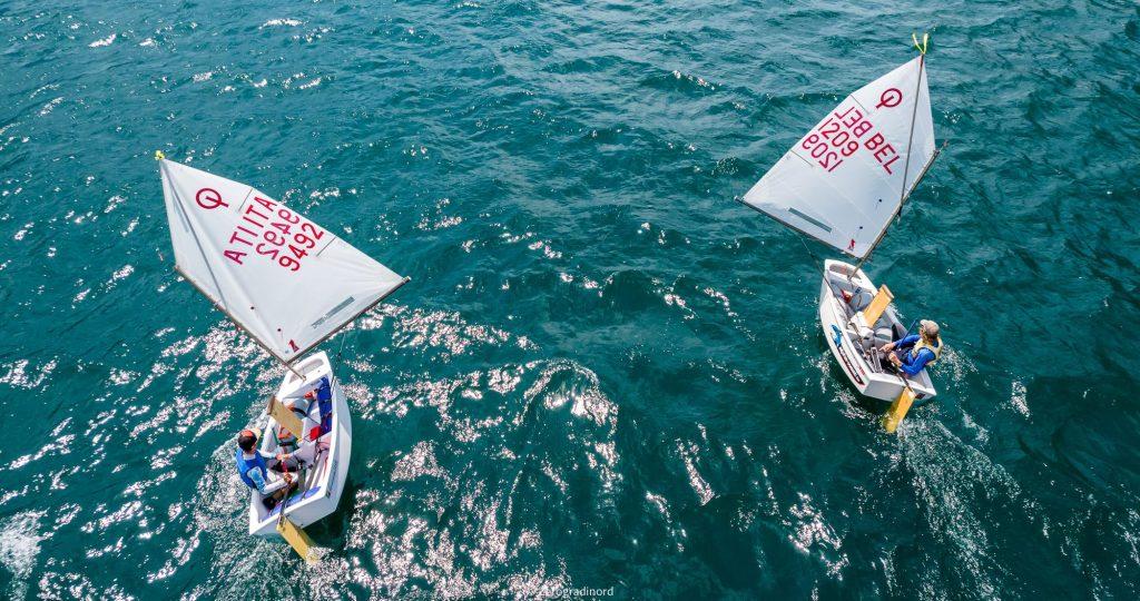 2 optis sailing downwind