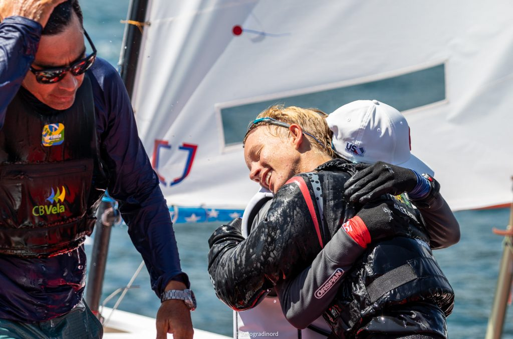 Sailors hugging after Brazil comes away with regatta win
