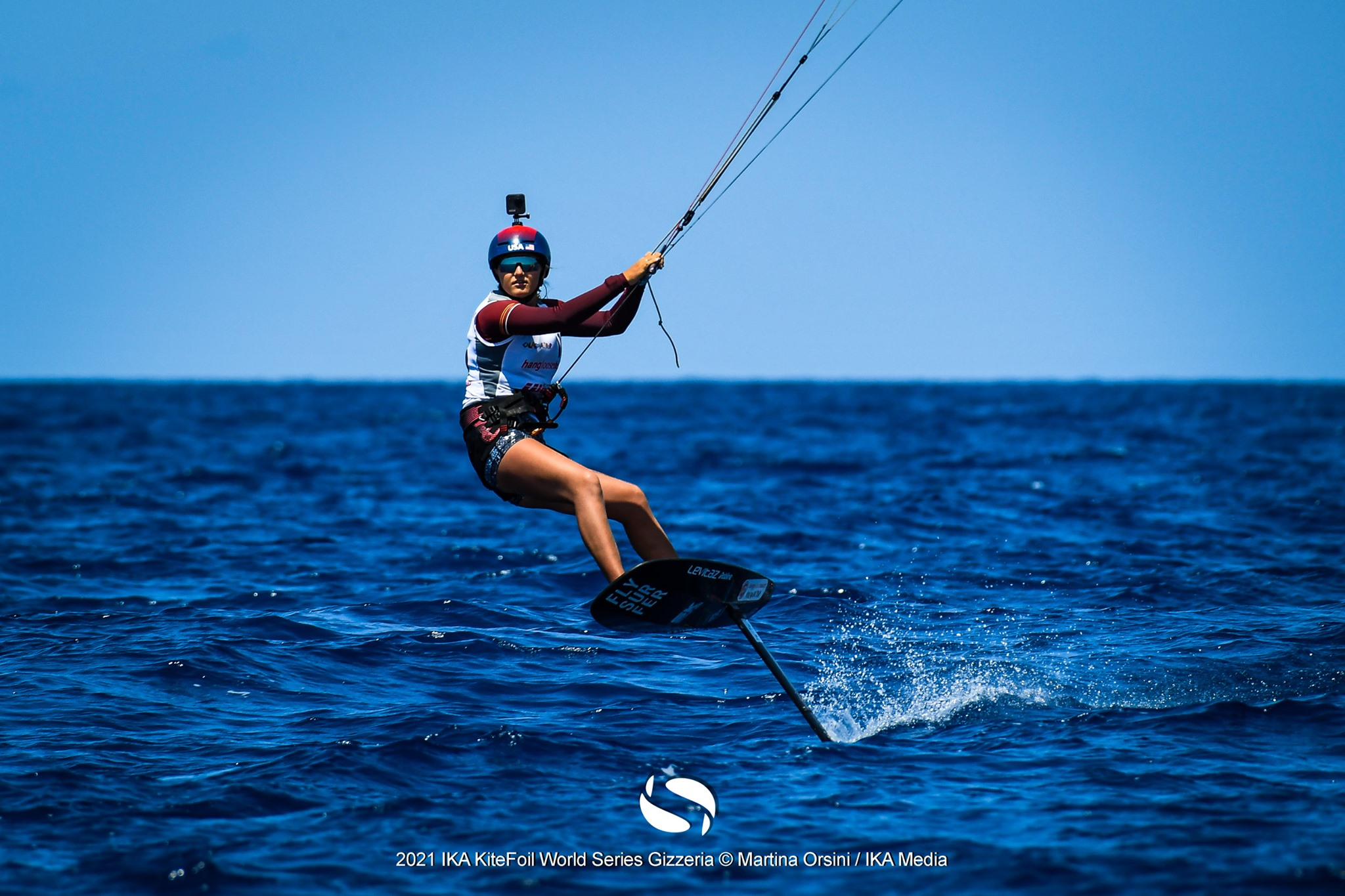 Female sailor heading for the camera on the foil