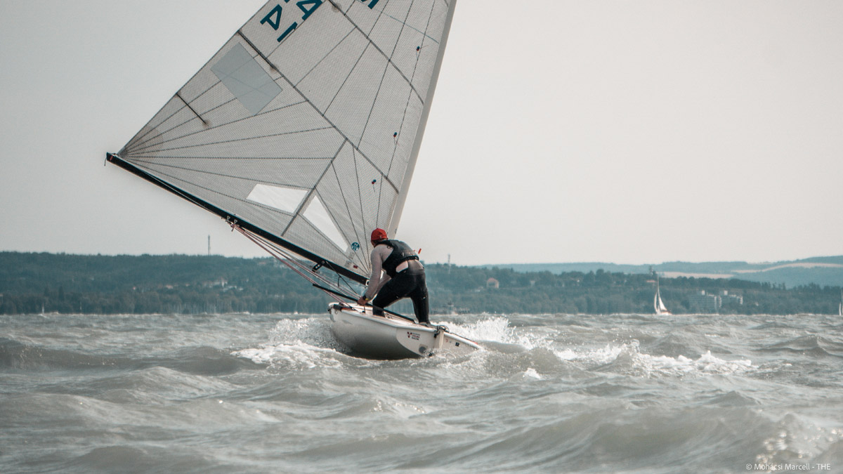 Sailor about to gybe