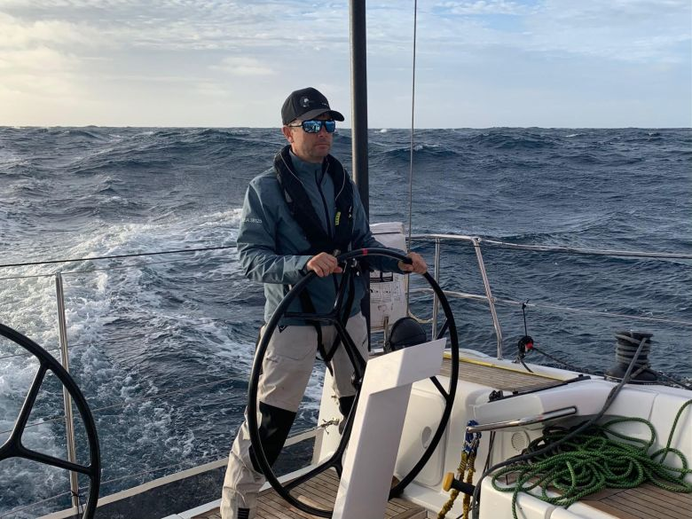 Sailor behind wheel offshore