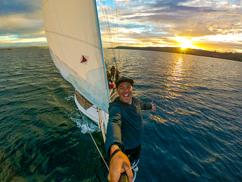 Selfie from the bow of the boat with sunset in background