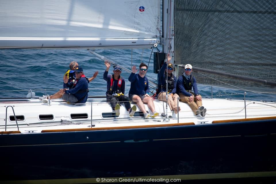 Waving at camera as they sail