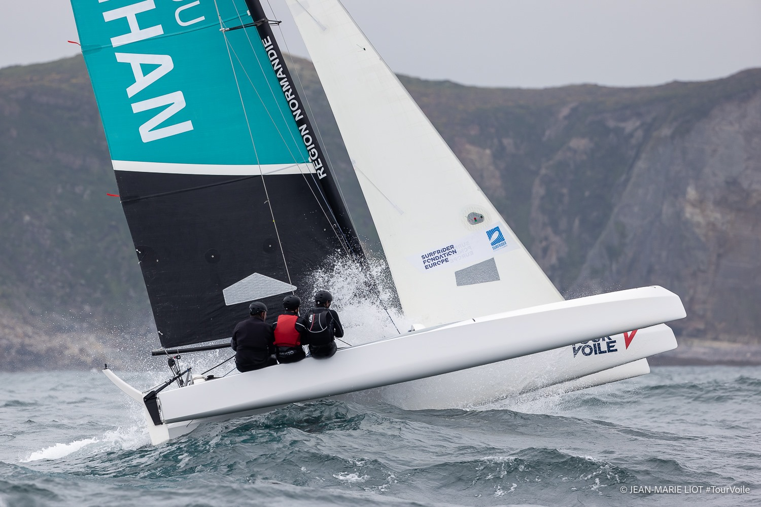 Boat making way upwind through choppy conditions