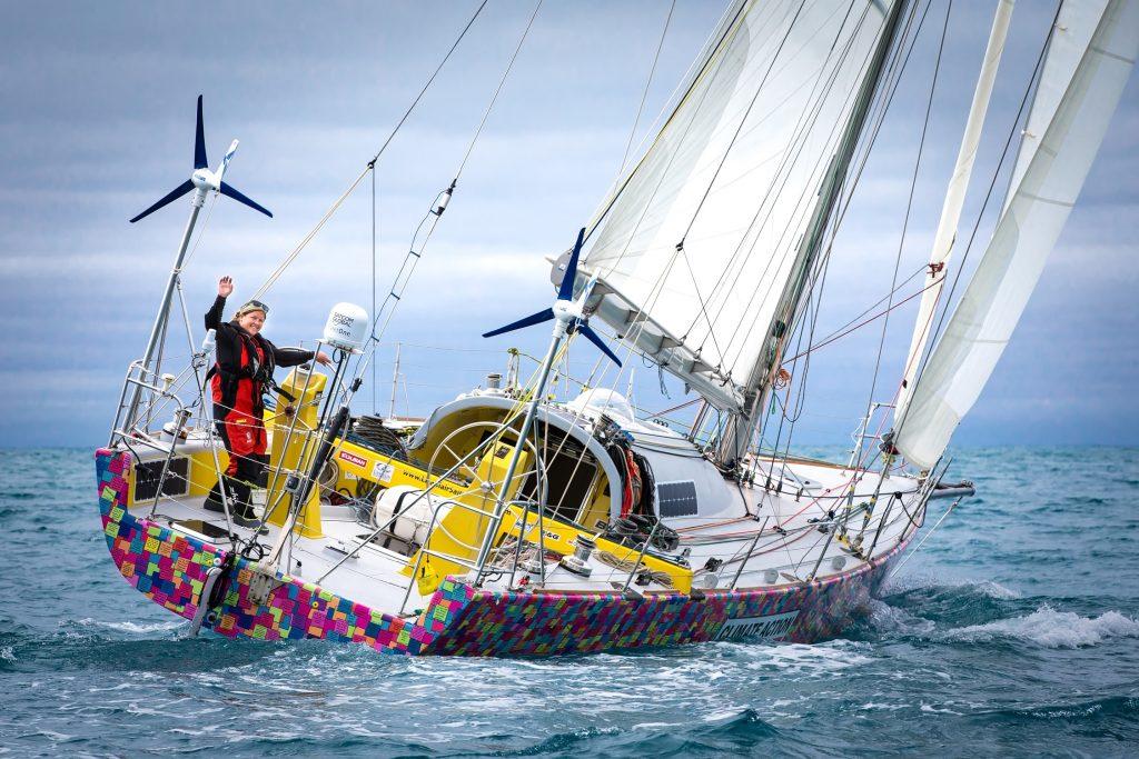 Lisa Balir sailing, waving at camera