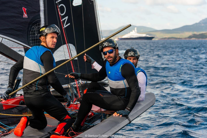 Sailors looking at camera, chilling between races