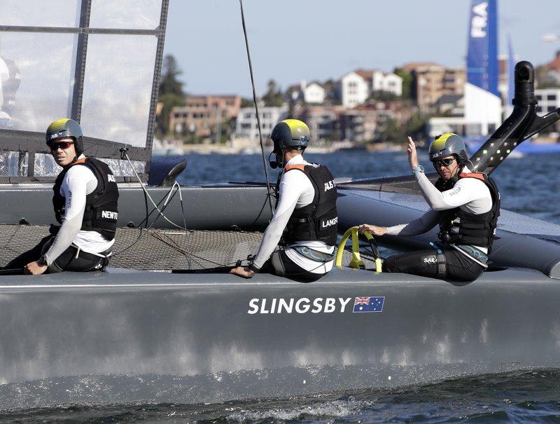 Tom Slingsby on SailGP boat waving at camera