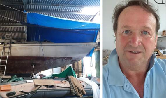 Dafydd Hughes pictured with the yacht he is working on to take part in the Global Solo Challenge.