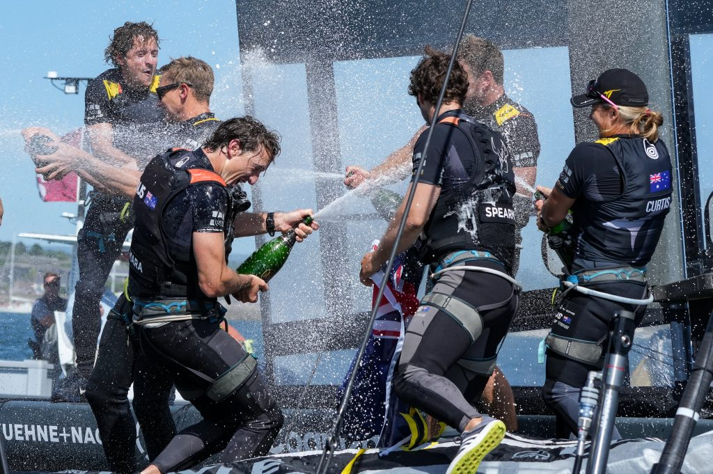 Australia SailGP Team helmed by Tom Slingsby celebrate winning Great Britain SailGP with Champagne Barons de Rothschild, Event 3, Season 2 in Plymouth, UK. 18 July 2021.