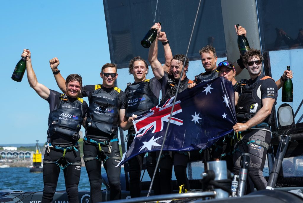 Australia SailGP Team helmed by Tom Slingsby celebrate with Champagne Barons de Rothschild after winning Great Britain SailGP.