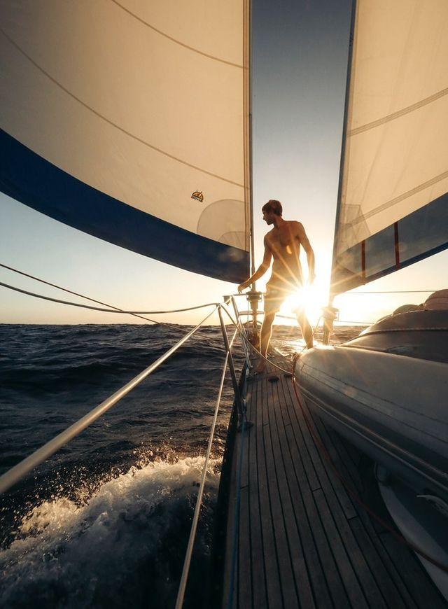 Sailor on bow sunset