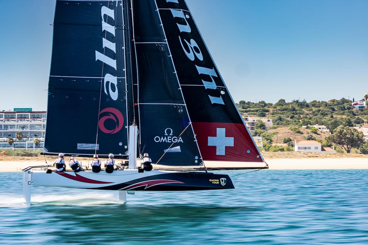 Ernesto Bertarelli's defending GC32 World Champions on Alinghi sailing upwind