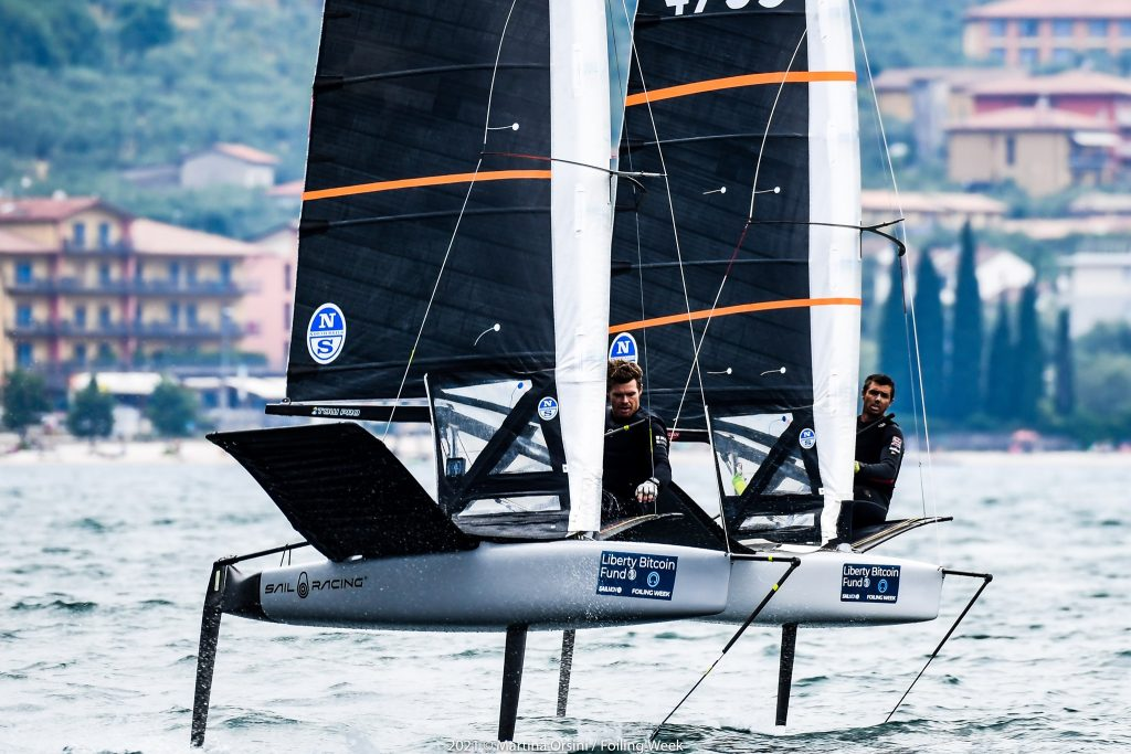Tom Slingsby and fellow Australian Iain Jensen competing at Foiling Week on Lake Garda.