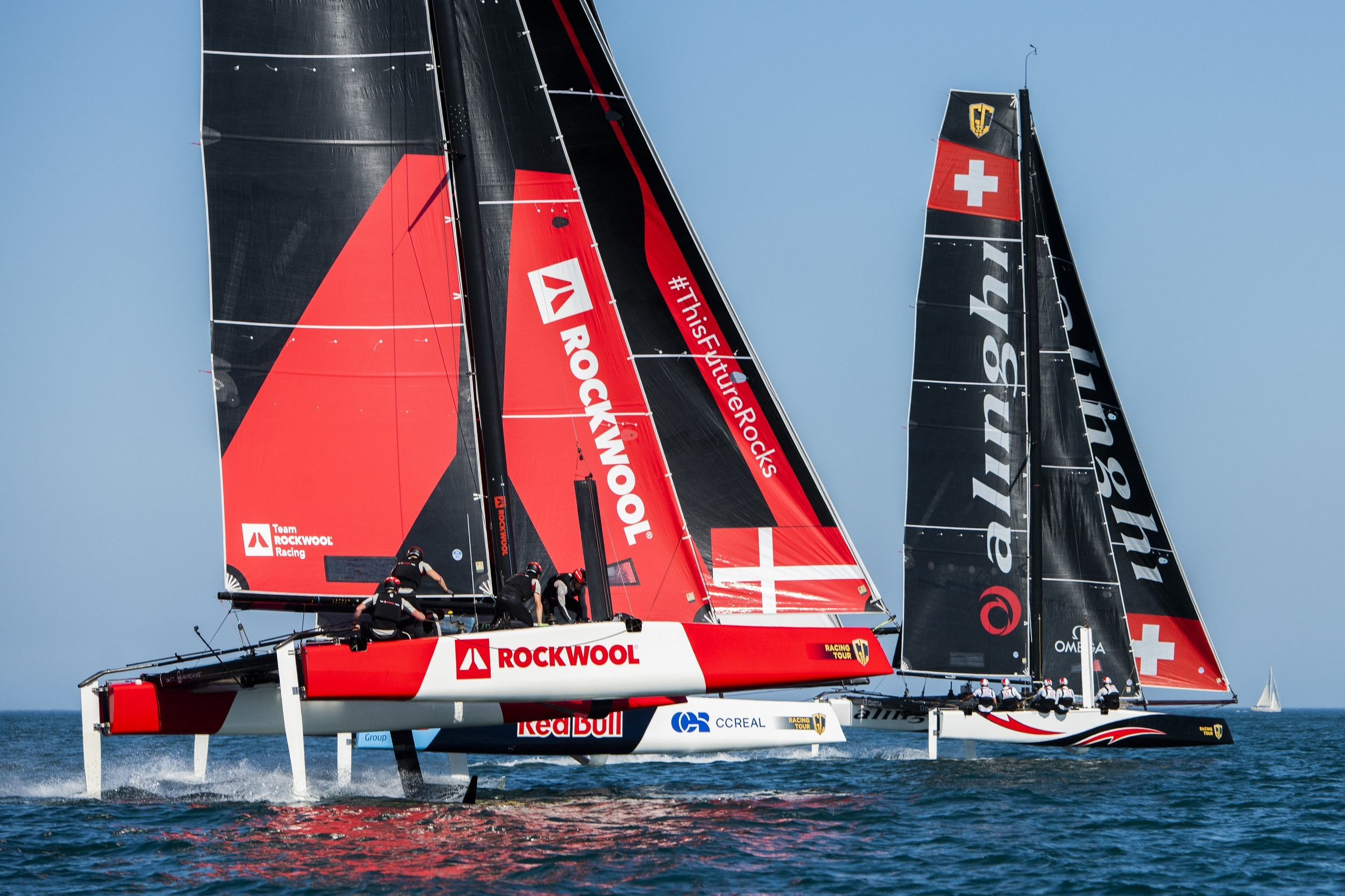 Alinghi leads Red Bull Sailing Team and Team Rockwool Racing down the reach.