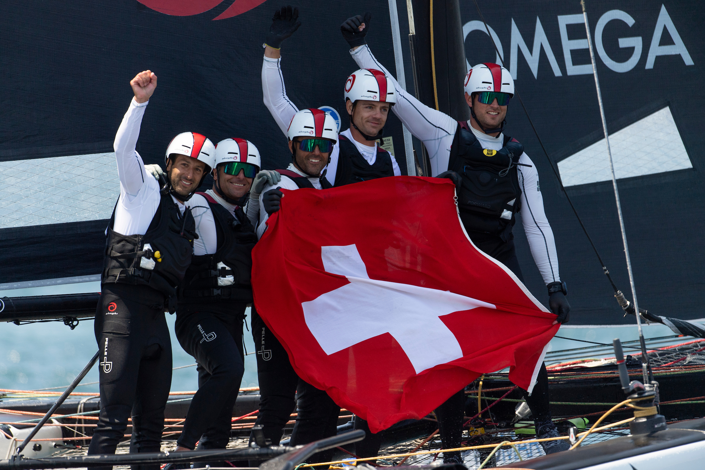 Ernesto Bertarelli's Alinghi team celebrate their win