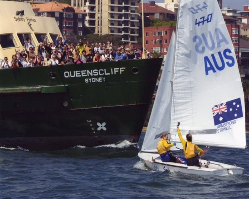 Sailors celebrating their win with spectators on a ferry at the 2000 Olympic Games in Sydney
