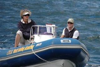 Jenni Bonnitcha on a speed boat, coaching / umpiring.