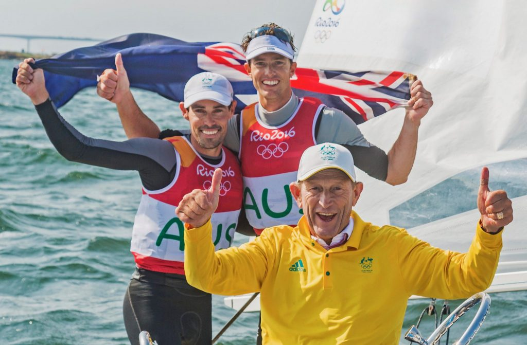 Victor Kovalenko, Mat Belcher and Will Ryan celebrating the silver medal at Rio 2016.