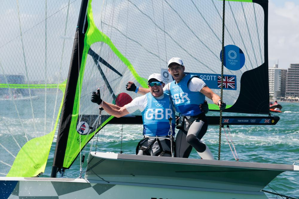 49er sailors Dylan Fletcher and Stu Bithell (GBR) celebrating their win after the race.