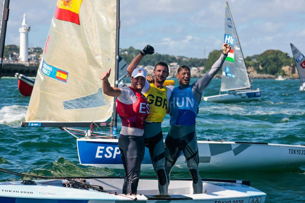 The fin bronze, gold and silver medalists celebrating after the Medal Race.