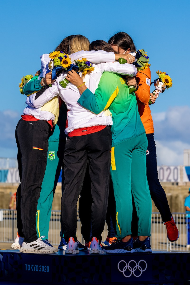 49erFX Olympic medalist hug it out at the awards ceremony.