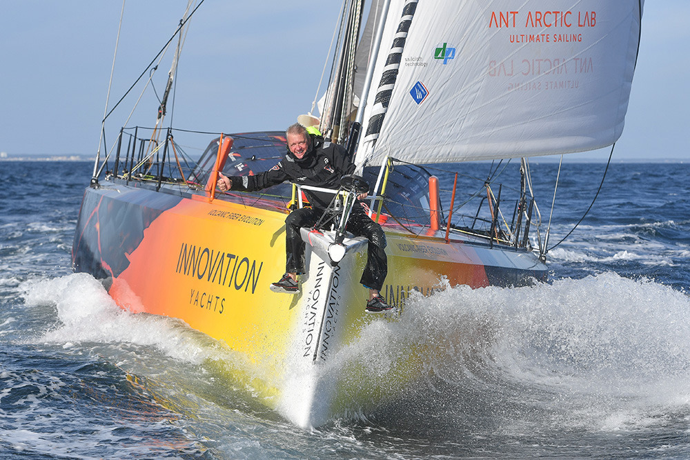 Norbert Sedlacek on the bow of his boat