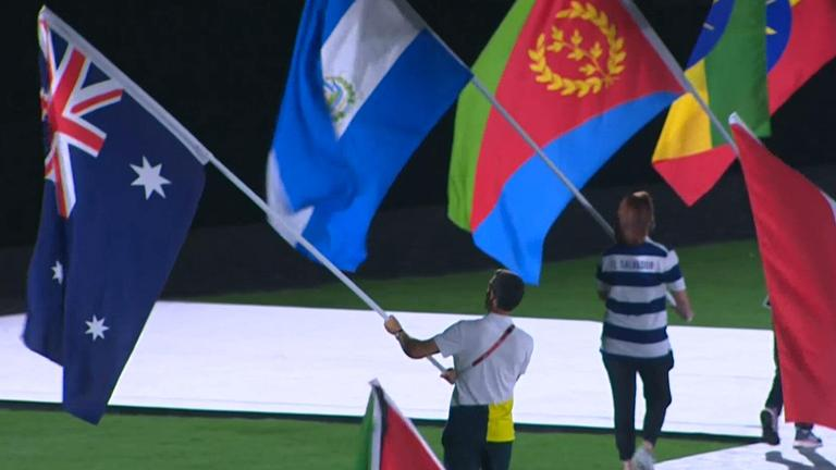 Mat Belcher carrying the Australian flag at the Tokyo 2021 Closing Ceremony.