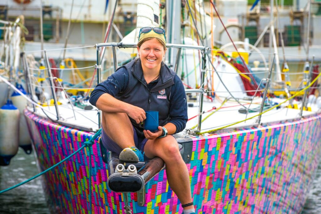 Lisa Blair on the bow of her boat (on the dock)