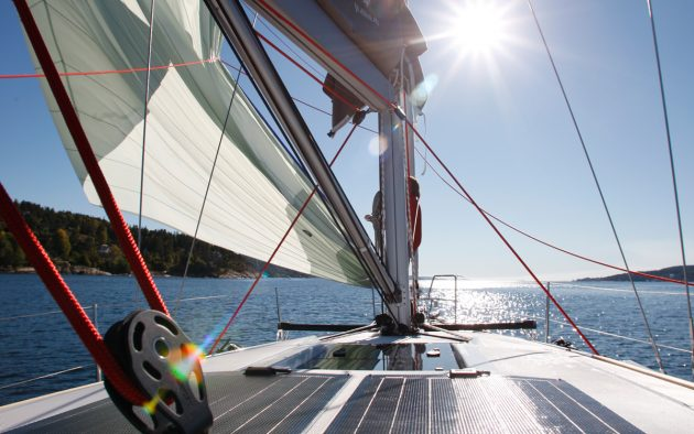A boat sailing (solar panels are just below the boom)