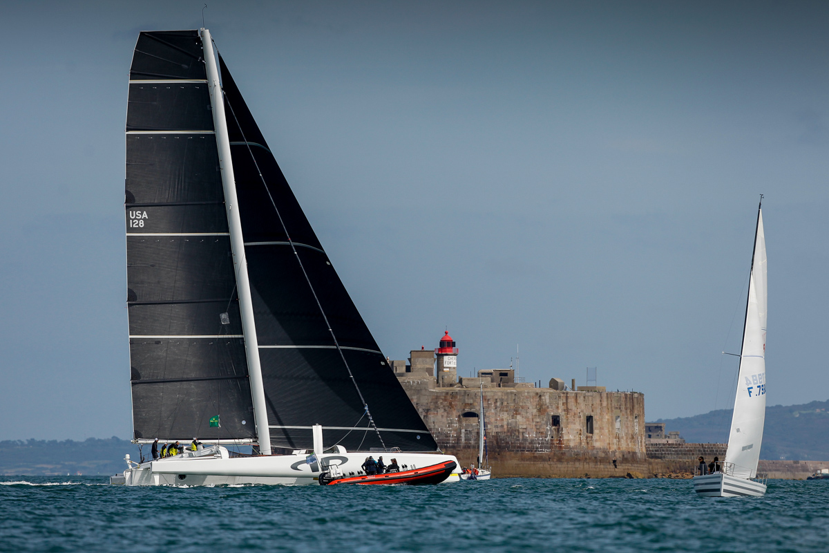 Jason Carroll's MOD70 Argo crosses the finish line off the light station on Fort De L'Ouest at 1522 BST.