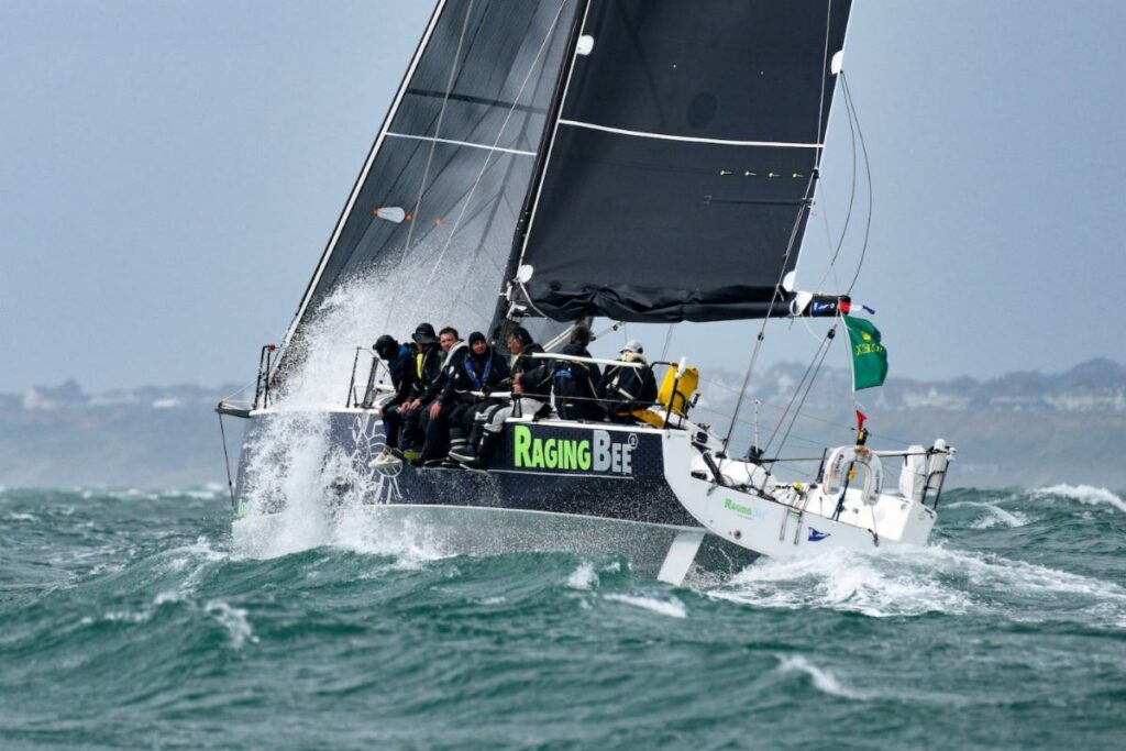 Raging-bee² is battling with three others for the lead in IRC Three after rounding the Fastnet Rock.