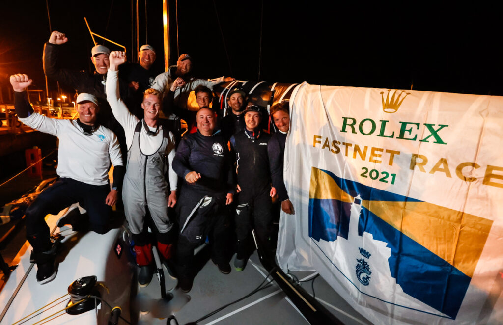 Dockside celebrations as RORC Commodore James Neville and crew on his HH42 Ino XXX finish the Rolex Fastnet Race in Cherbourg and lead IRC One.